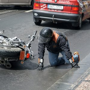 The man fell off a motorcycle Harley Davidson V-Rod on wet road