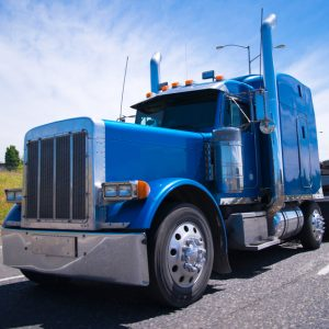 Big rig semi truck blue wolf of roads