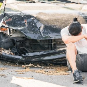 Man upset next to wrecked car