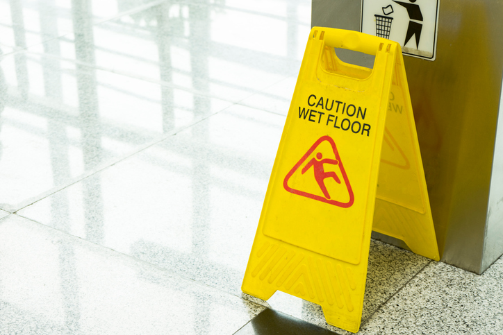 caution sign in office slip and fall