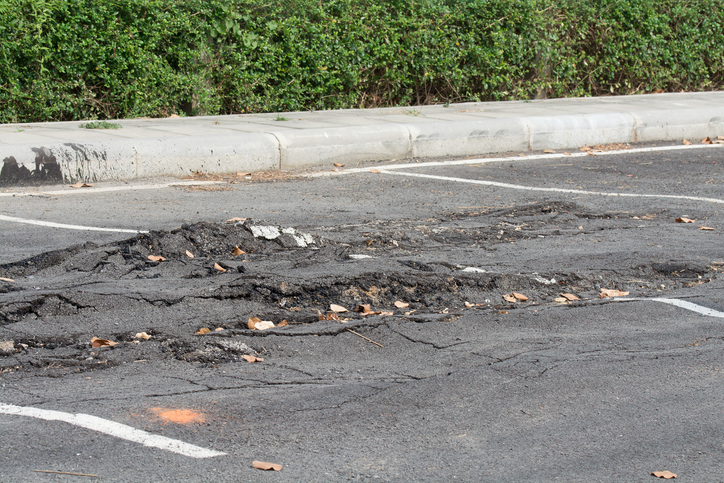 asphalt parking lot potholes and damage